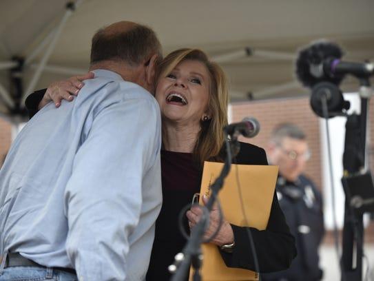 U.S. Rep. Marsha Blackburn hugs Bernie Ellis, who helped