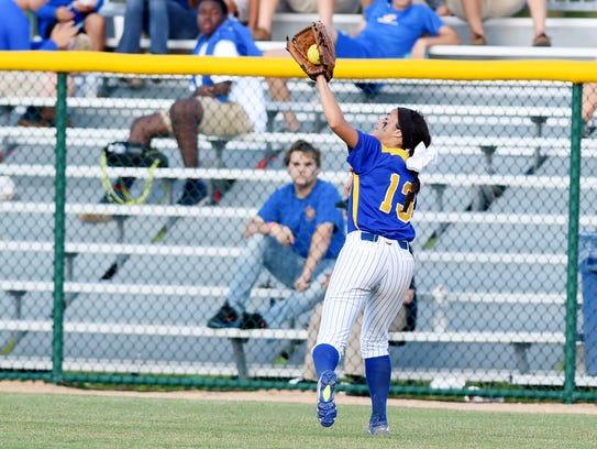 John Carroll Catholic's Cammeo Presutti runs down a fly ball against Lakeland Christian during the 2017 Class 3A state championship game, Thursday, May 18, 2017, at Historic Dodgertown in Vero Beach. The Golden Rams won 4-1 and are back this year to defend their state title.