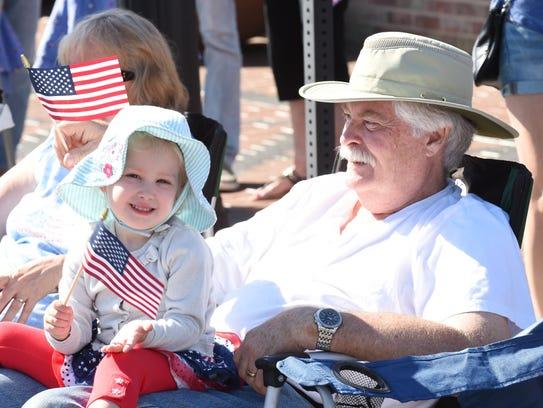 Kate Garvey sits with Grandfather Tim Garvey of Farmington