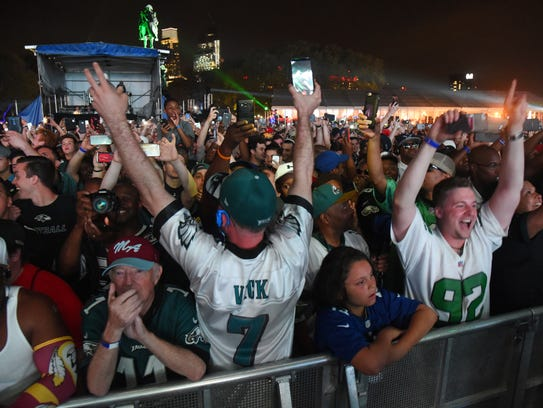 Fans react after the Eagles' draft selection at the 2017 NFL draft at the Philadelphia Museum of Art.