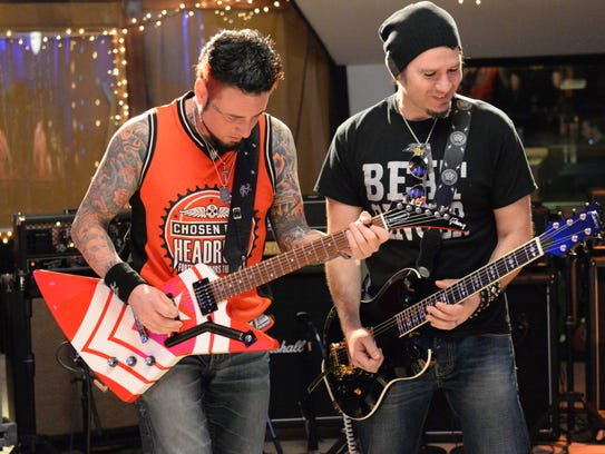 Jason Hook (left) and Phil X in a scene from the new