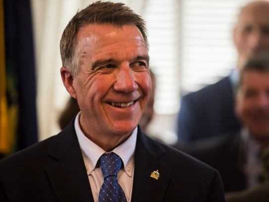Gov. Phil Scott smiles after signing the 2018 budget