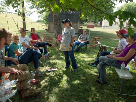 A shady tree offers the World Changers volunteers a