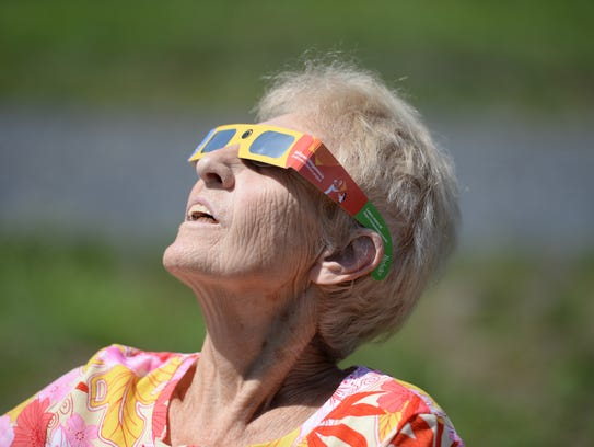 Althea Smallwood of Grottoes watches the eclipse during
