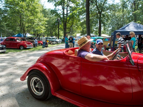 Wally Kasher drives a 1933 Ford Roadster with Doug