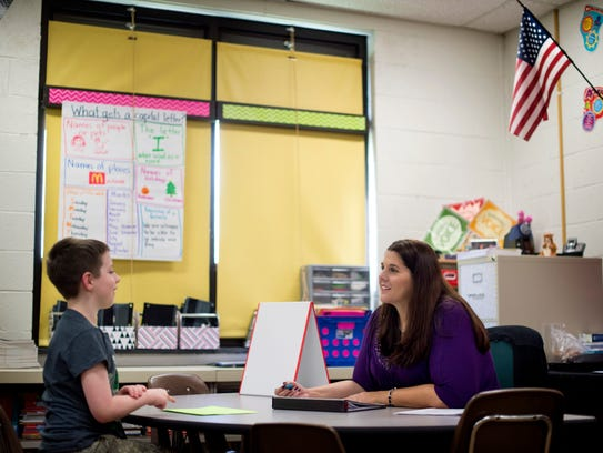 Jennifer Payne works with students individually for