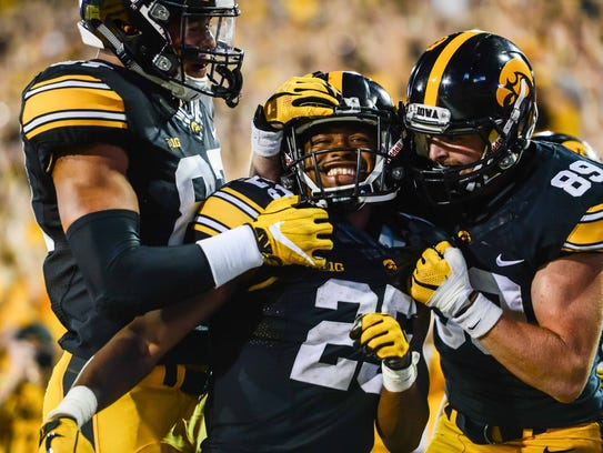 Iowa Hawkeyes running back Akrum Wadley (25) celebrates