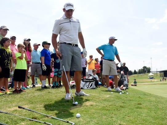 Golf pros Scott Stallings, left, and Josh Broadaway