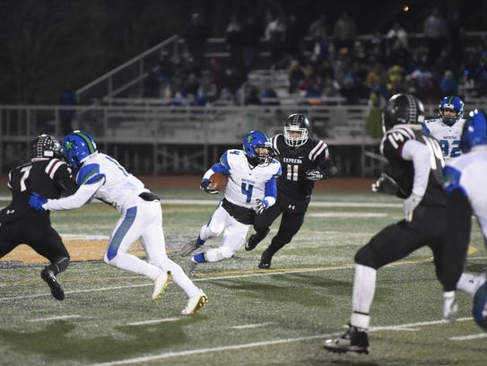 Quarterback Conner Hayes helped lead Cicero-North Syracuse's running attack in their 57-14 victory over Elmira in the Section 4 Class AA quarterfinals.