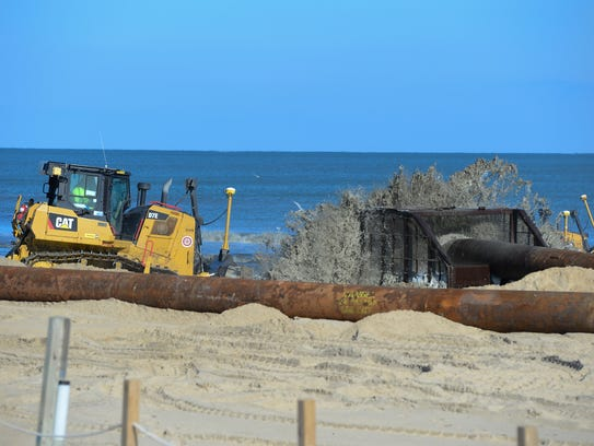 In this file photo, the Great Lakes Dredge & Dock Company works to renourish the beaches in Ocean City on Monday, Nov. 20, 2017.