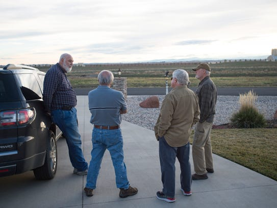 Dave Kisker and neighbors chat across the road from