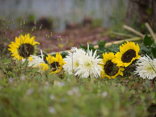 Flowers are left as a memorial for Chelsea Noel, 4,