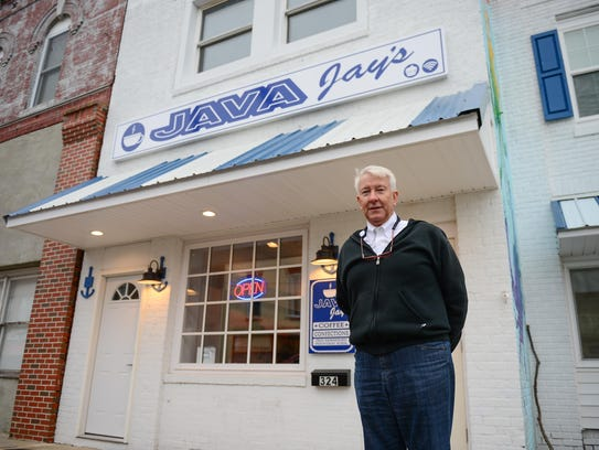 Jay Tawes, owner of Java Jay's, stands outside his coffee shop in Crisfield on Wednesday, Dec. 6, 2017.