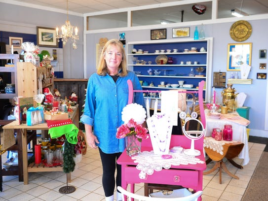 Timeless Charm co-owner Diane Ellison poses for a photo in their newly opened shop in Salisbury.