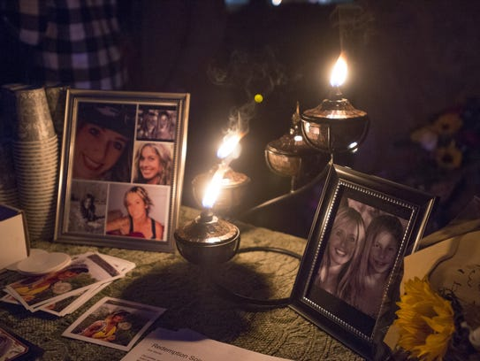 Photos of Kimberlee Graves are illuminated by candles