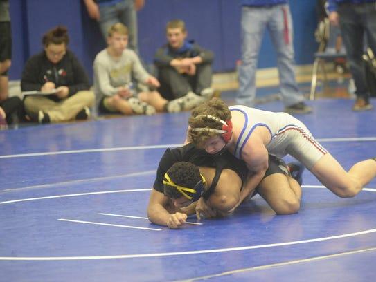 Union County's Tucker Coffman wrestles Jacob Duncan