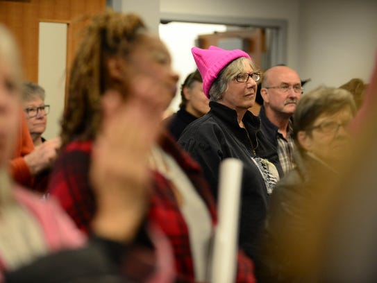 Attendees of the Women's March Sussex listen to the
