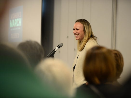 Meghan Wallace, Mary Ann's List, speaks to the attendees of the Women's March Anniversary Celebration held at the Lewes library on Sunday, Jan. 21, 2018.