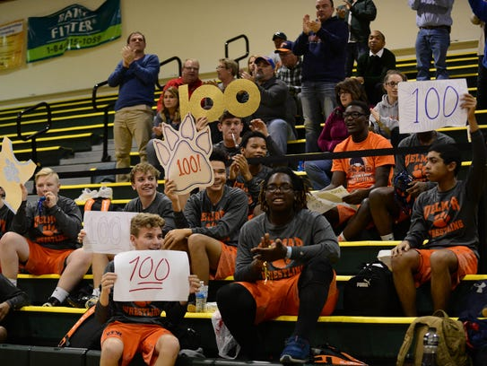 Isaac O'Neal's Delmar teammates celebrate his 100th win on Wednesday at Indian River High School.