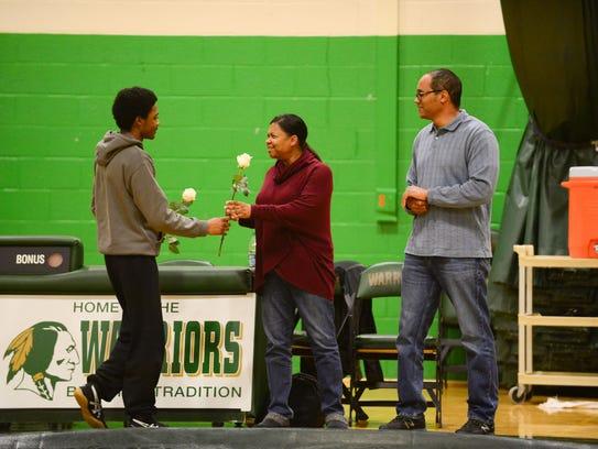 Mardela's Logan Trader, gives his parents roses during