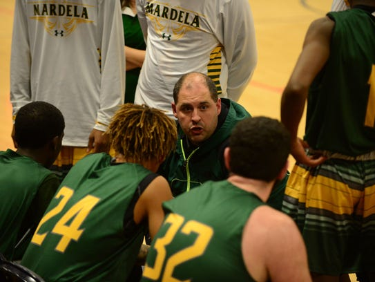 Mardela's head coach Matthew Mayette talks to his team