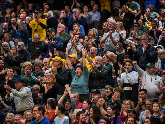 The crowd reacts to a drive by Trae Bell-Haynes, the
