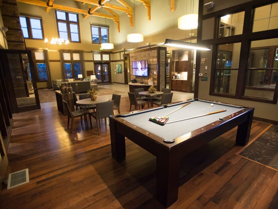 A pool table is set up and ready to play int he clubhouse