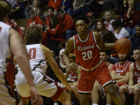 Richmond's Christian Harvey (20) moves the ball during