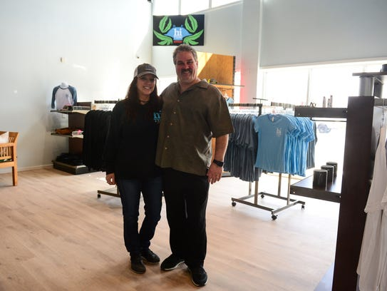 Bob and Sherri Davis, Hi Tide co-owners, stand in the lobby of their dispensary store located in West Ocean City, Md.