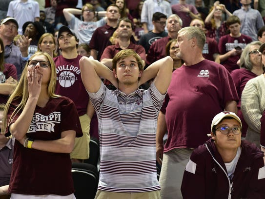 Mississippi State fans react to the three-pointer made