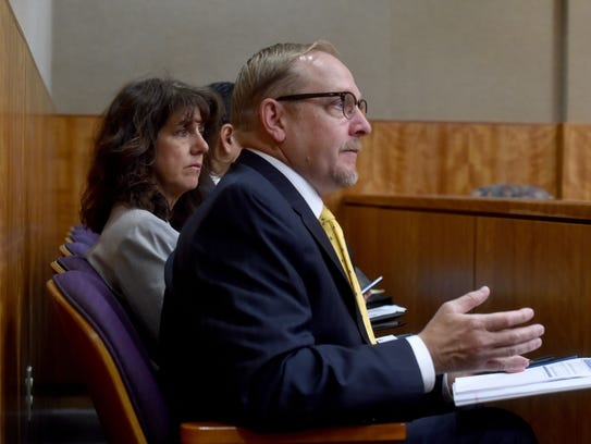 Chuck Hughes (right), a chief deputy district attorney,