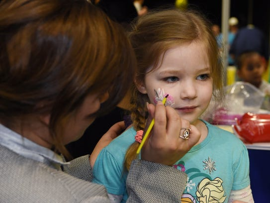 Ellie Rosa, 4, of Highland gets some face-painting