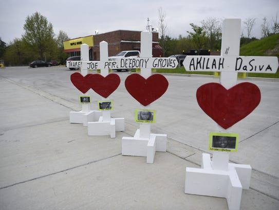 Crosses remembering the four victims who died in a