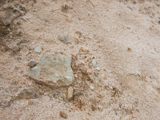 Large rocks, like this one at a former sand trap, were