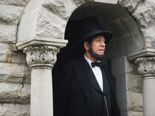 Tom Wright dressed as Abraham Lincoln stands in the