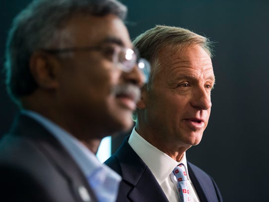 At right Governor Bill Haslam answers questions from