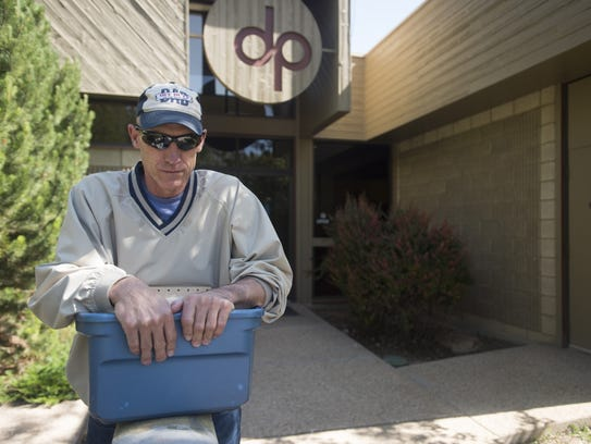 Jeff Gillespie pauses outside after a vision therapy