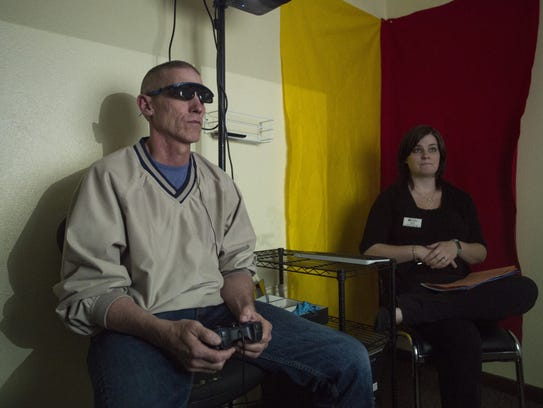Jeff Gillespie uses a pair of glasses and a controller