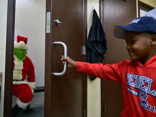 TyLon Pittman, 5, locks up the Grinch in the Byram Police