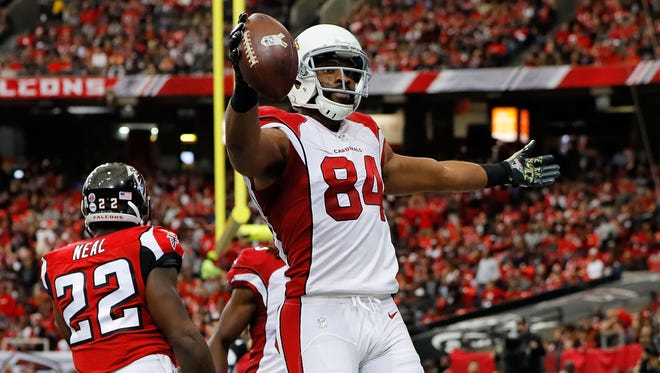 Jermaine Gresham #84 of the Cardinals celebrates after catching a touchdown pass during the first half against the Falcons at the Georgia Dome on November 27, 2016 in Atlanta.