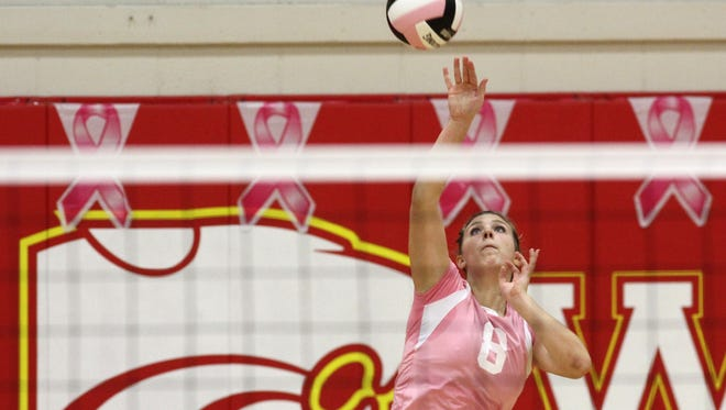 Carlisle junior Agatha Beier serves against Ballard. Carlisle hosted Ballard Oct. 6 for pink-out night to promote breast cancer research. Carlisle won in four games.
