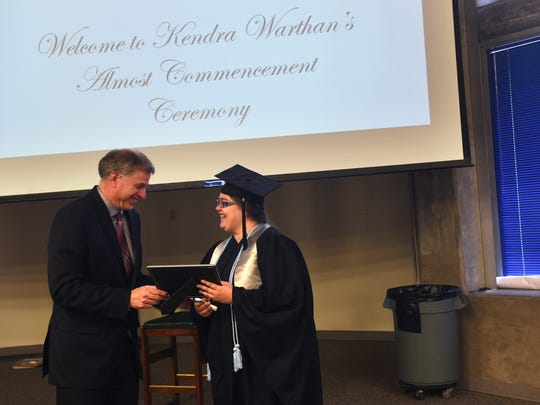 "Dean of the College of Education Dr. Kenneth Coll, left, presents Kendra Warthan with her diploma at her ""Almost Commencement Ceremony"" in the Jot Travis building at the University of Nevada, Reno on Jan. 31, 2017."