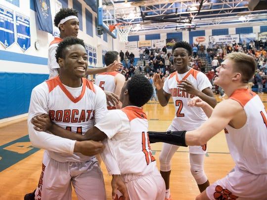 Northeastern celebrates after defeating Archbishop