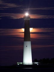 The Supermoon rises behind the Barnegat Lighthouse Wednesday evening, January 31, 2018.