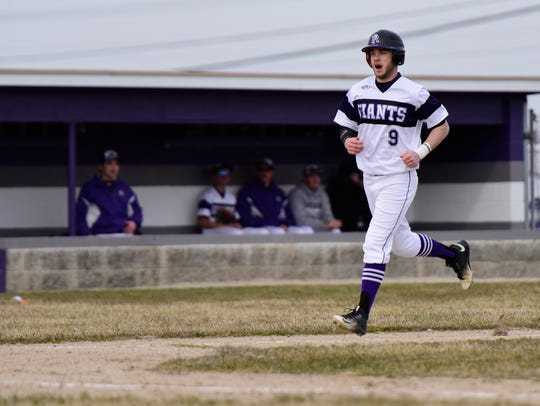 Noah Hotz scores a run Monday for Fremont Ross.