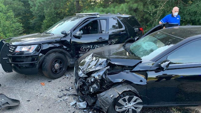 A car rammed into a parked Oconee County Sheriff's Office patrol unit early Monday after the car's driver said she was forced off the road by a large truck.