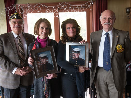 George Karatzia, Patricia Malloy with photo of son Michael Breen and Debbie Dailey with photo of her son James Veth, and Christopher Diamantoukos.