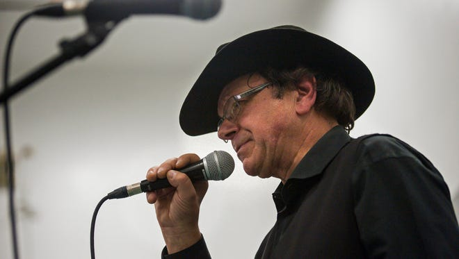 Johnny Cash, as portrayed by George Richard of Burlington, performs for inmates at the Marble Valley Regional Correctional Facility in Rutland on Wednesday, November 30, 2016.