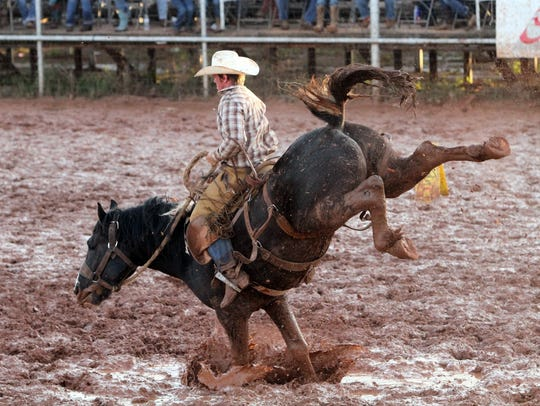 Ethan Richardson rides a bronc to score a 77 at the