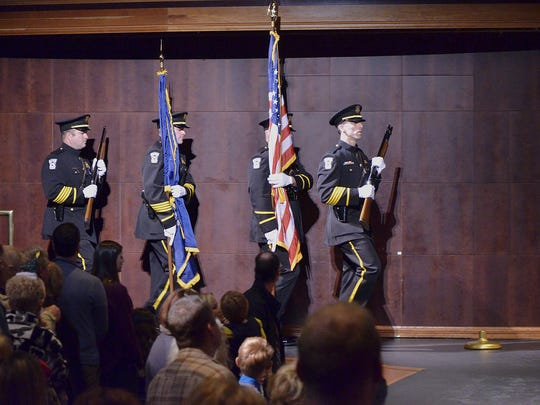 The Canton Police Department honor guard posts the colors.